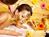 foto of cleopatra  - Woman getting  gold facial mask - JPG