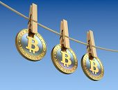 Bitcoins  with wooden clothespin