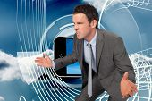 Businessman posing with hands out against energy design on a futuristic structure