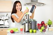 Vegetable juice raw food - healthy eating woman with juicer juicing green vegetables and apple fruit