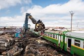 scrap metal machine disassembling a train