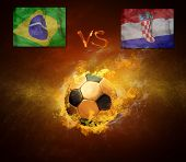 Hot soccer ball in fires flame, friendly game beetwin Brasil and Croatia