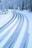 winding winter road in Etna Park