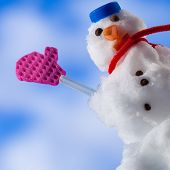 Happy Christmas Snowman With Pink Gloves Waving To You Outdoor. Winter.