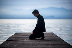 image of muslim man  - Muslim man praying on an empty dock - JPG