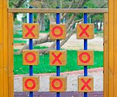 stock photo of tic  - wooden tic tac toe in a green park - JPG