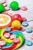 Sweets And Chewing Gum On A Wooden Table