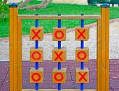 foto of tic  - wooden tic tac toe in a green park - JPG