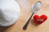 Text Love With Sugar In A Cup On Wood Table Background