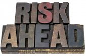 risk ahead - isolated words in vintage letterpress wood type with ink patina