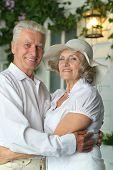 Elderly couple on veranda