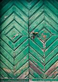 Old And Dilapidated Wooden Door In Turquoise Color