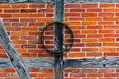 Brick Wall Of  Half Timbered House And Iron Hoop
