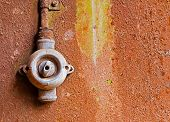 Old Switch On Rusty Iron Wall