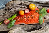 Wild Salmon Fillet Placed Inside Of Diftwood