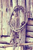 Old rope on wooden background