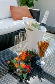 Terrace With Champagne Glasses And Champagne Bottle In Cooler
