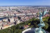 Lyon, France, viewed from the top of Notre Dame de Fourviere, with statue of St George. Mont Blanc i