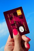 Hand Holding Credit Card With Sky As Background