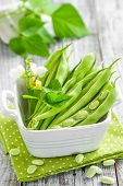 foto of bean-pod  - Green beans with leaves on a table - JPG