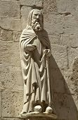 Ancient cleric statue on the side facade of Santa Maria Maggiore church, Caramanico Terme, Abruzzo r
