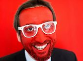 Adult businessman with red painted face