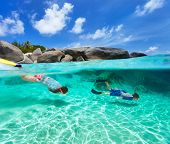 Split photo of mother and son family snorkeling in turquoise ocean water at tropical island of Virgi