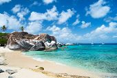 The Baths beach area major tourist attraction at Virgin Gorda, British Virgin Islands with white san