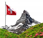 Beautiful mount Matterhorn with Swiss flag on white background