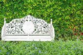 White Classic Chair In The Garden
