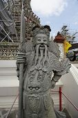 Chinese Statue In The Buddhist Temple Of Wat Arun