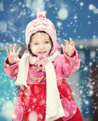 Baby girl playing on winter playground