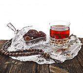 Ramadan festival eastern  drink with dates in wooden table isolated on white background