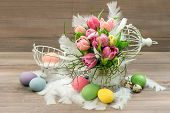 Pastel Colored Tulip Flowers And Easter Eggs