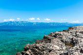 Rocky Coast Of Korcula On The Adriatic Sea In Croatia