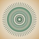 Green and beige tribal circle design.