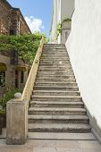 image of bannister  - Closeup details of set of old stone steps against wall - JPG