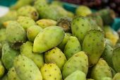 stock photo of prickly pears  - Pile of various prickly pears or cactus fig for sale at a market on Madeira Portugal - JPG
