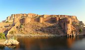 landscape with fort and lake in Jodhpur India at sunset