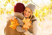 lovely couple hugging in autumn forest
