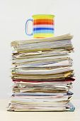 Coffee Mug on Stack of Files