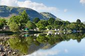 image of tent  - Campsite tents at Ullswater Lake District Cumbria England UK with mountains and blue sky on beautiful calm sunny summer day with reflections and clouds from sunny weather - JPG