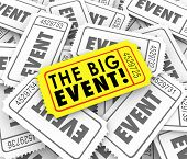 The Big Event Words on a yellow ticket over many admission passes advertising