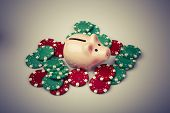 Pig Money Box With Casino Chips Over White
