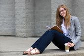 Confident Young Woman Reading Her Journal