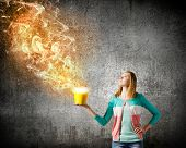 Young girl holding bucket with flying out fume