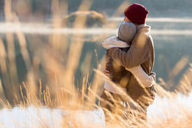 image of hug  - back view of lovely young couple hugging in winter - JPG