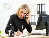 Middle-aged businesswoman working in office.