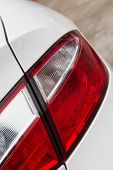 Close Up Look Of A Taillight Of A White Car Vertical