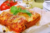 stock photo of lasagna  - Portion of tasty lasagna on table - JPG